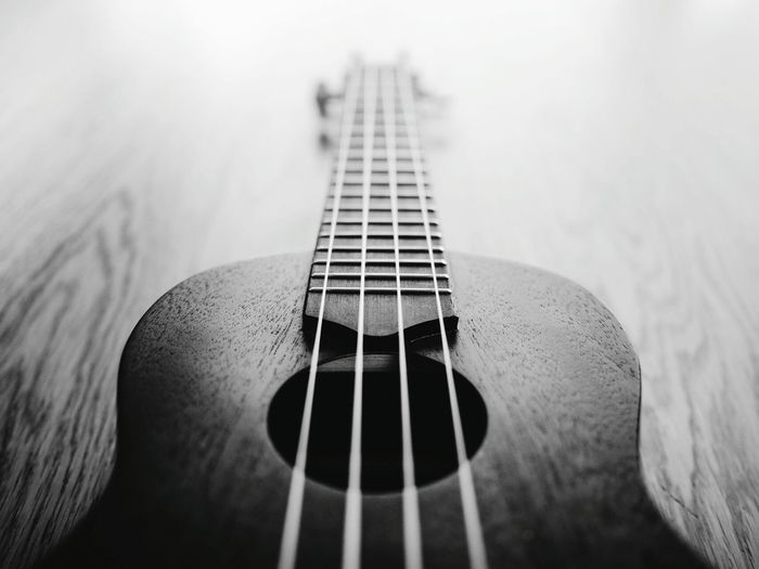 Close-up of acoustic guitar on table
