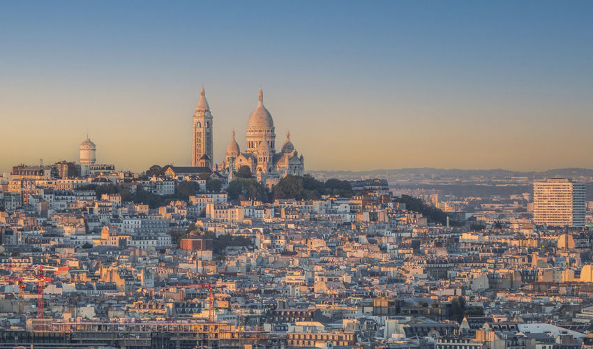 Aerial view of paris with montmartre in background at sunset