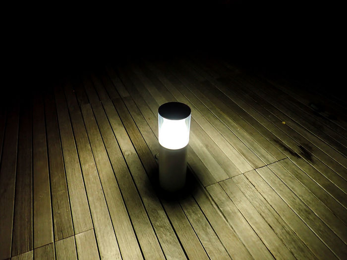 High angle view of illuminated lamp on table