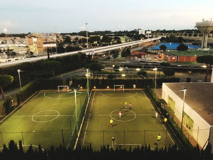 Watching Soccer game from hotel window at airport in Rome, Italy High Angle View Architecture Built Structure Large Group Of People Sport Outdoors Playing Leisure Activity Soccer Men Airpiort Travel Travelling Play Stressreliever