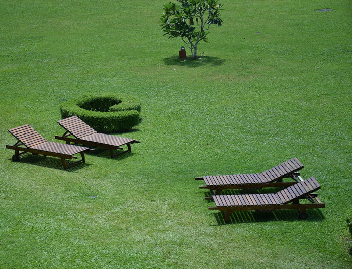 High Angle View Of Lounge Chairs In Lawn
