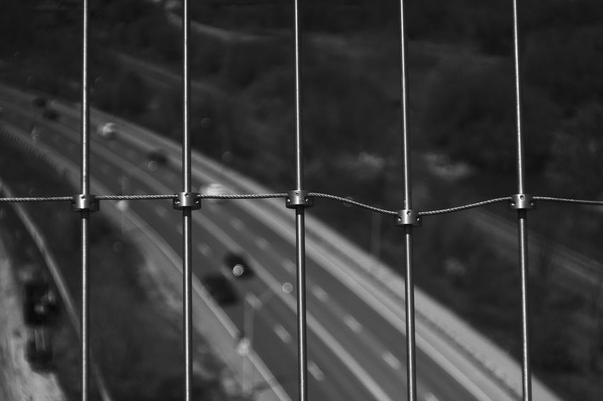 """Luminous Veil."" The suicide prevention barrier on the Bloor viaduct in Toronto, Ontario. Black & White Black And White Black And White Photography City Close-up Day Depth Of Field Don Valley Focus On Foreground Highway Leading Lines Metal Monochrome Outdoors Perspective Protection Road Somber"