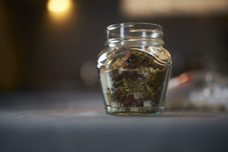 Close-up of glass of jar on table