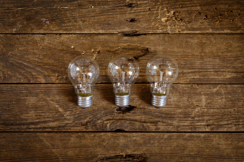 Backgrounds Choice Close-up Directly Above Fuel And Power Generation Glass Glass - Material Glowing Group Of Objects High Angle View Household Equipment Indoors  Light Bulb Lighting Equipment No People Simplicity Still Life Studio Shot Table Variation Wood Wood - Material Wood Grain