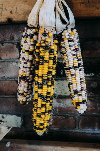 Close-up of corns hanging at market stall