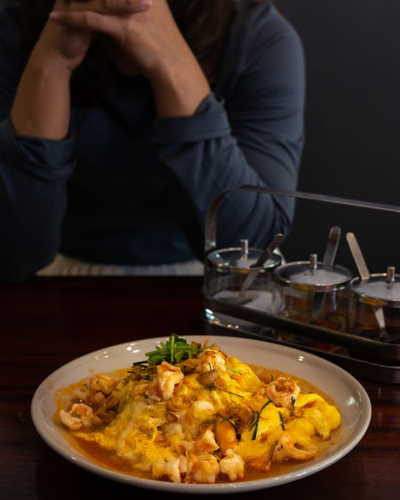 Midsection of man having food in plate