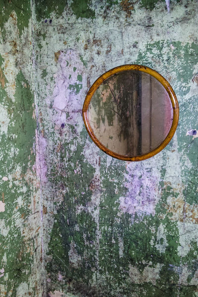 Round Wooden Frame Mirror Wall Abandoned Damaged Plastering Plaster Paint Flaking Paint Flaking Green Damp Moss Mould Mold Dirty Walls Paintwork Day Colour Image Vertical No People Old Buildings Old