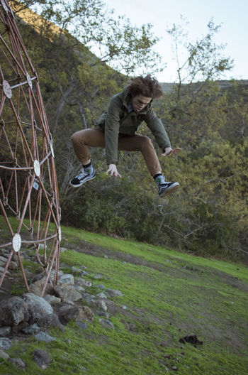 Portrait of man jumping in park