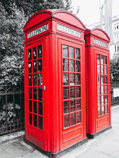 Red telephone box in London British London Red Telephone Booth Telephone Box England English Red Red Telephone Red Telephone Box Telephone Telephone Booth