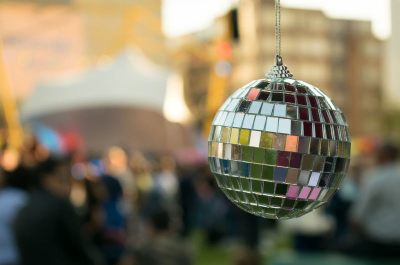 Close up image of a disco ball Arts Culture And Entertainment Close-up Day Disco Ball Focus On Foreground Hanging Incidental People Outdoor Outdoors Party People Real People