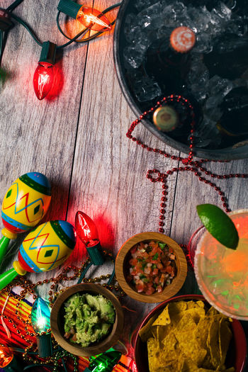 Mexican holiday Cinco De Mayo series with drinks, food, colorful lights and lots of fun. Cinco De Mayo Cinco De Mayo! Food And Drink Holiday Margarita Wood Backgrounds Chips And Salsa Copyspace Drink Food Mexican Overhead Overhead View Poster Background Table