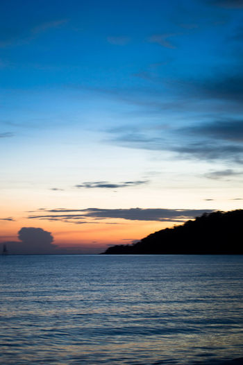 Beauty In Nature Blue Day Horizon Over Water Idyllic Nature No People Orange Color Outdoors Scenics Sea Silhouette Sky Sunset Tranquil Scene Tranquility Water Waterfront