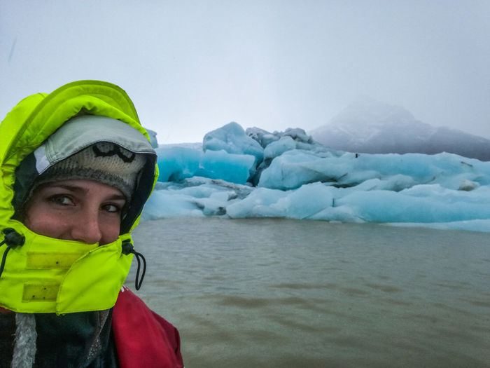 One Person Woman Iceberg Warm Clothing Water Snow Cold Temperature Sea Winter Adventure Mountain Glacier Ice Iceberg - Ice Formation Lagoon Iceland Arctic Polar Climate
