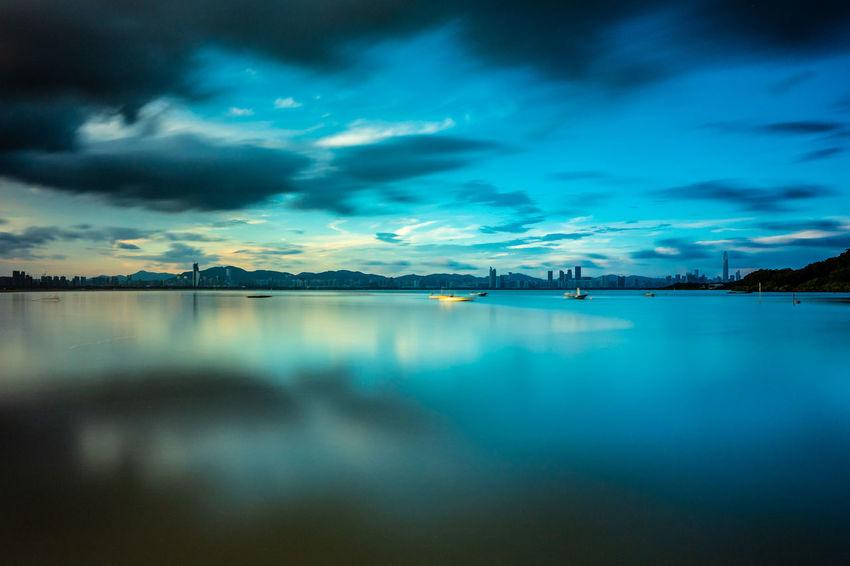 Water Astronomy Sea Cityscape City Mountain Illuminated Sunset Harbor Blue