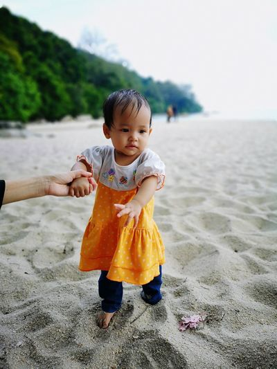 Learn to walk Beach Water Walk Girls EyeEm Selects Sand Pail And Shovel Sandcastle Shovel Bucket Möp Trick Or Treat Winking Baby Clothing A Coruña Human Tongue Babyhood Sandal One Baby Girl Only Shore One Baby Boy Only FootPrint Preschooler Unknown Gender
