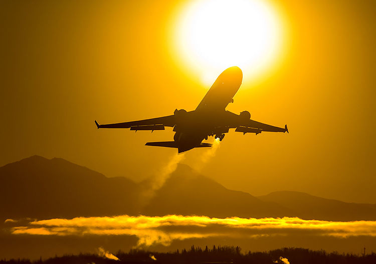 Air Vehicle Sunset Sky Flying Orange Color Airplane Mode Of Transportation Transportation Mid-air Travel Yellow Silhouette Sunlight Sun Nature Beauty In Nature No People Cloud - Sky Scenics - Nature on the move Outdoors Aerospace Industry