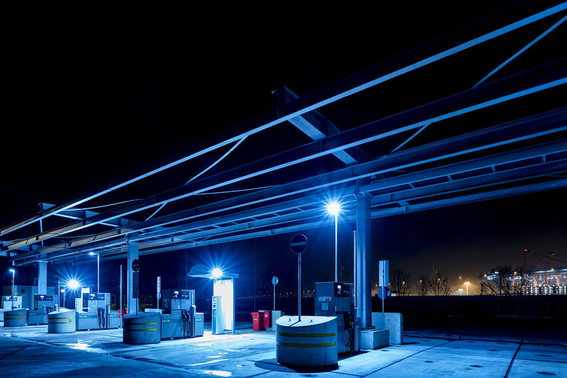 filling station Capture Tomorrow Illuminated Night Architecture Built Structure City Building Exterior Transportation Lighting Equipment Street Gas Station Mode Of Transportation Fuel And Power Generation No People Refueling Fuel Pump Street Light Bridge Outdoors Motion Road Light