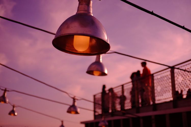 Low angle view of lantern hanging against sky