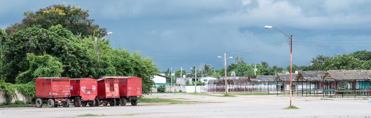 Las Tunas, Cuba - September 4, 2017: View of an empty fairgrounds in the city. Cuba Framing Las Tunas Cuba Vacant Vacant Lot Business Cloud - Sky Cuban Life Day Empty Lot Fairgrounds Industry Nature No People Outdoors Red Rusting Sky Train Transportation Tree EyeEmNewHere EyeEmNewHere