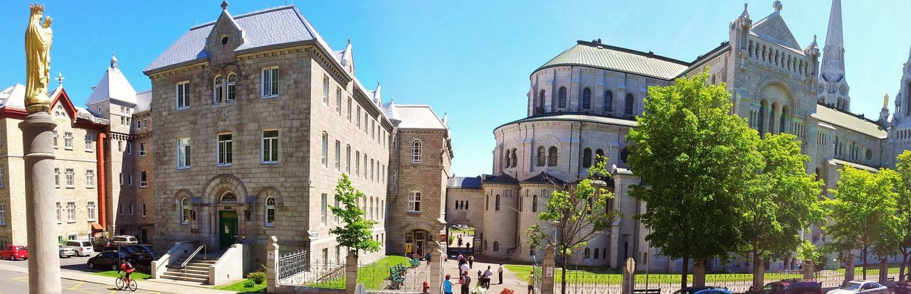 Architecture Building Exterior Built Structure Church City Clear Sky Day Façade Incidental People Place Of Worship Religion Spirituality Street Sunlight Travel Travel Destinations Tree Sainte Anne De Beaupre Basilica Visits