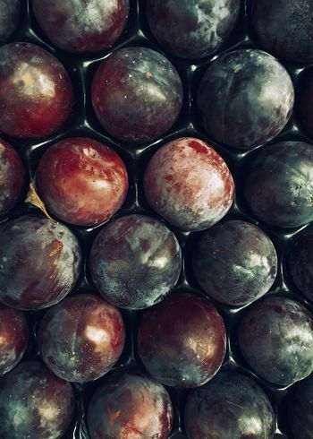 Plums Vertical Shot Food Healthy Eating Food And Drink Wellbeing Full Frame Backgrounds Freshness Fruit Still Life Textured  Directly Above Repetition Market For Sale Close-up Indoors  Abundance Large Group Of Objects Retail  Plums Vertical Vitamin Baking