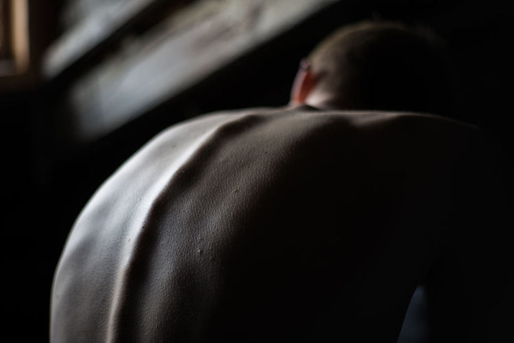 One Person Rear View Indoors  Lifestyles Focus On Foreground Real People Men Adult Midsection Human Body Part Body Part Depression Depression - Sadness Mood Dark Human Back Emotion Males