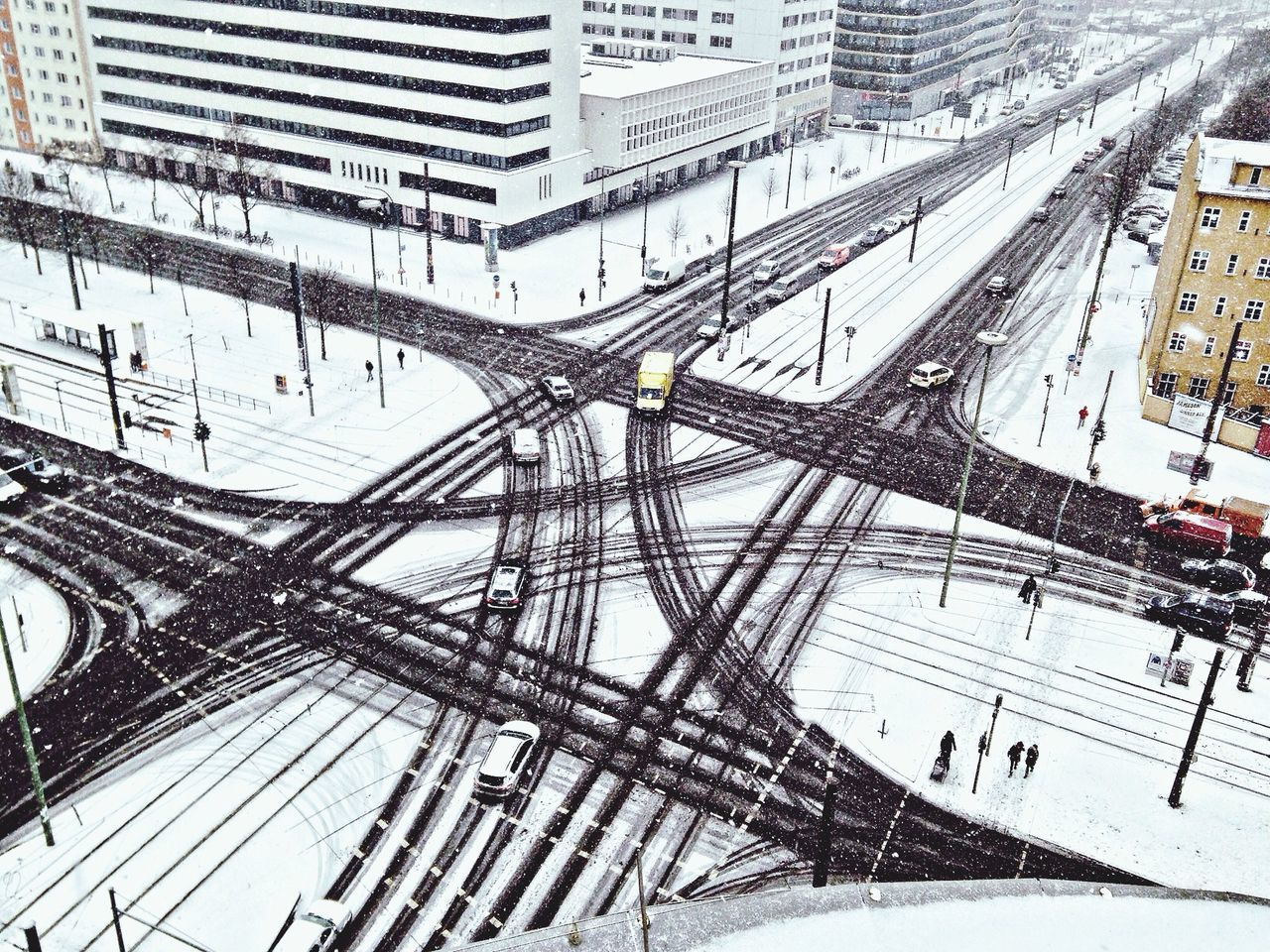 High angle view of snow covered street in city