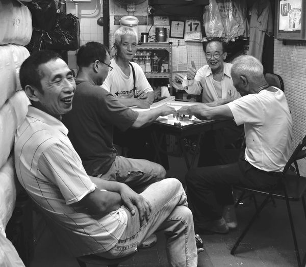 A Game of Mahjong Hong Kong Street Shot Arts Culture And Entertainment Board Game Enjoyment Game Group Of People Indoors  Leisure Activity Leisure Games Mahjong Mahjong Session Men People Playing Senior Adult Senior Men Sitting Smiling Street Street Photography