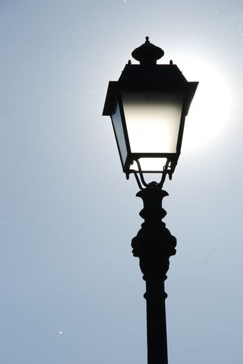 The sun is hiding in the lantern. Looks almost like a black and white photo.No People Outdoors Low Angle View Day Lantern Lucca Italy