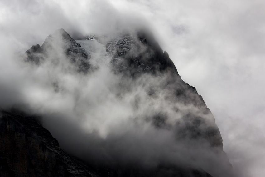 Wild weather in Rosenlaui Valley, clouds ripping up for moments only, giving me a brief look up Wetterhorn. Adventure Beauty In Nature Berner Oberland Cloud - Sky Clouds Glacier Ice Field Majestic Mountain Mountain Range Mountaineering Mountains And Clouds Mountains And Snow Nature Outdoors Ridge Rock Formation Rosenlaui Sky Swiss Alps Weather Wetterhorn Wild Mountains Black And White Friday