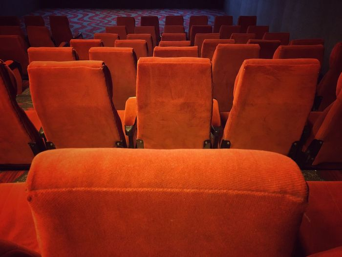 High angle view of empty red chairs in movie theater