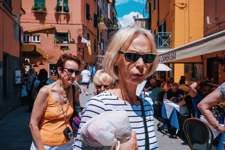 Shades out Sunglasses Glasses Fashion Architecture City Adult Building Exterior People Lifestyles Leisure Activity Women Group Of People Real People Casual Clothing Sunlight The Street Photographer - 2018 EyeEm Awards