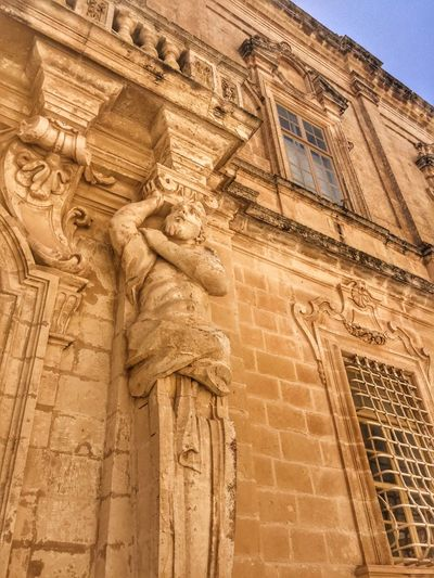 Facade view with medieval art in Rabat, Malta Architecture Bas Relief Building Exterior Built Structure Day History Low Angle View Medieval Architecture No People Outdoors Sculpture Sky Statue Travel Destinations