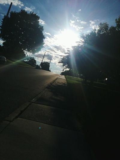 The morning sun Outdoors No People Tree Sky Nature While Walking Clouds Beauty In Nature Residential Street Sidewalk Street Sunshine Sun Morning Sun