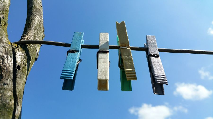 Low Angle View Of Clothespins