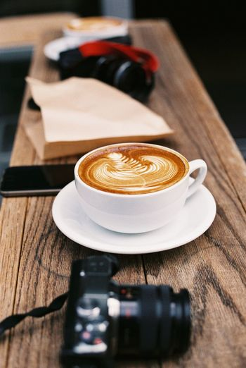 Camera Cappuccino Coffee Coffee - Drink Coffee Cup Drink Food And Drink Healthy Lifestyle Indulgence Latte Latteart Lifestyle Music Preparation  Refreshment Relaxing Spoon Still Life Streetphotography Table Temptation