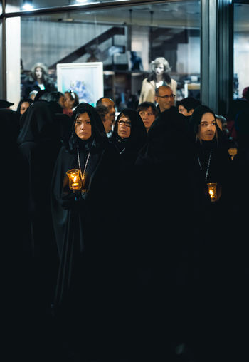 Zamora, Spain - March 31, 2018: Ladies of the Virgin of Solitude during holy week (semana santa) in Zamora, Spain. The ladies wear rigorous mourning, with a black cloak with a cap, with a distinctive medal and with a glass tulip. Holy Week Semana Santa Easter Week Woman Women Candle Candlelight Ladies Virgin Mary Prayer SPAIN Procession Easter Religion Zamora Catholic Tradition Parade Jesus Christ Faith Traditional Passion Brotherhood Ceremony Devotes