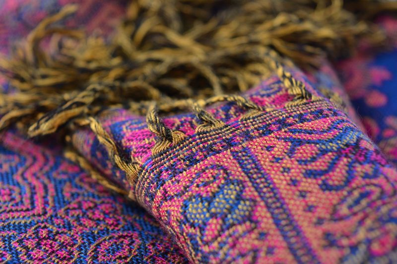 Brightly coloured wool scarf, selective focus. Close-up No People Indoors  Wool Day Texture Textures And Patterns Textures And Colors Selective Focus Weave Pattern Fabric Fabric Detail Fabric Texture Fabric Design Fabric Pattern Nobody Close Up Detail Details And Colors Bright Colors Cloth Textile Textures Textile Fabrics