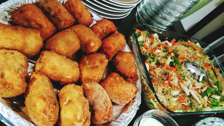 Pinoy Feast. #filipinofood #pansit #EyeEmNewHere #plate Vegetable Choice Close-up Food And Drink Deep Fried  Fried Chicken Serving Size Fried Food Chicken Tasty Fried