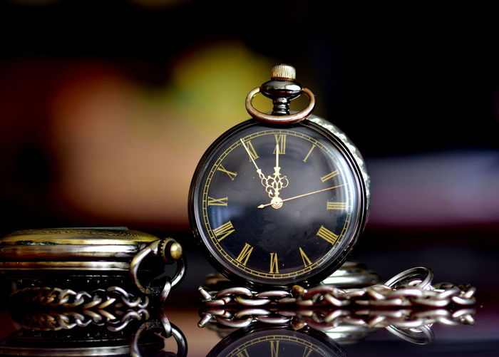 Close-up of pocket watches on table