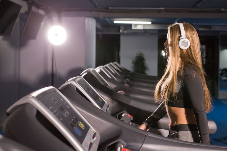 Side view of woman exercising at gym