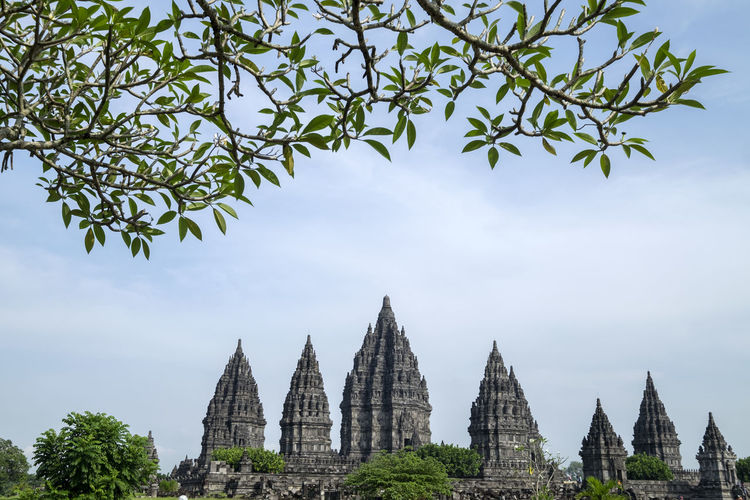 Beautiful prambanan temple Hinduism Holiday Holidays Vacations Yogyakarta, Indonesia Architecture Belief Building Built Structure Cloud - Sky Culture Destination Green Color Hindu Temple History Indonesia Photography  Nature Outdoors Plant Religion Sky Spirituality Stone Travel Destinations Tree