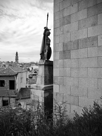 BeW City Cityscape Oporto, Portugal Architecture Art And Craft Black And White Building Building Exterior Built Structure Cloud - Sky Creativity Day History Human Representation Low Angle View Male Likeness Monochrome Nature No People Outdoors Representation Sculpture Sky Statue The Past
