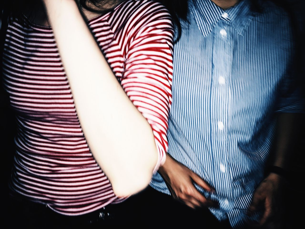 Midsection of women wearing striped clothes