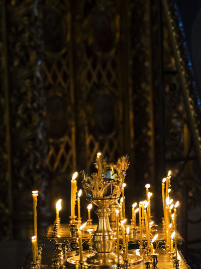 Lit candles on altar