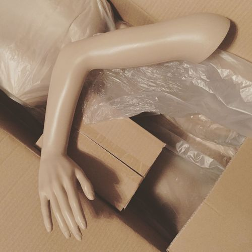 High angle view of mannequin in box
