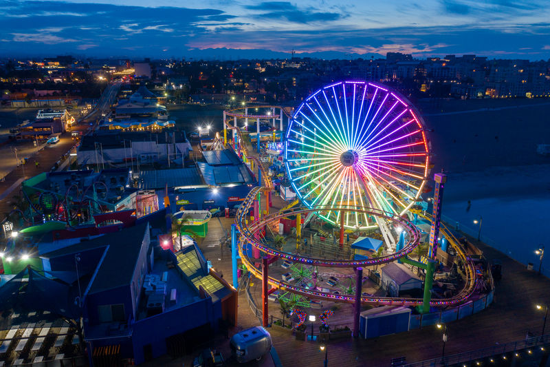 High angle view of illuminated ferris wheel at night