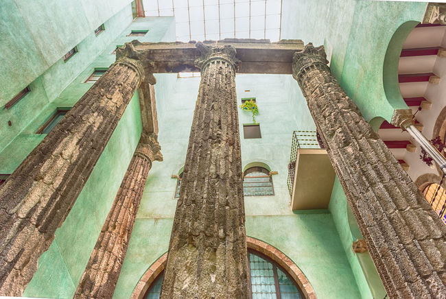 BARCELONA - AUGUST 8: Ancient ruins of roman columns at the Temple of Augustus in Barcelona, Catalonia, Spain, on August 8, 2017 Architecture Indoors  Built Structure No People High Angle View Old Building Day Wall - Building Feature The Past Weathered Wood - Material History Window Abandoned Staircase Architectural Column Ruined