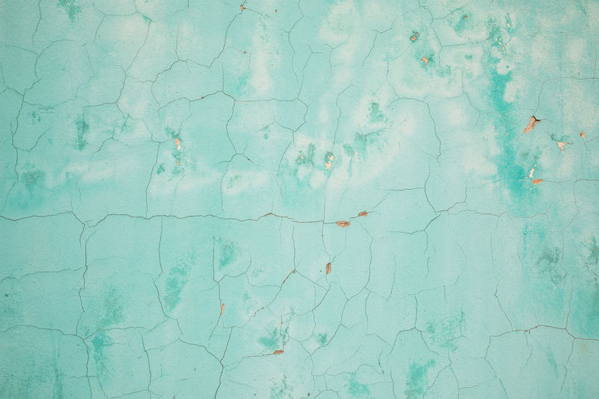 Full frame shot of a turquoise colored wall with cracks and paint coming off Abstract Aging Process Architecture Backgrounds Bad Condition Blue Building Exterior Built Structure Close-up Concrete Concrete Wall Copy Space Cracked Damaged Deterioration Façade Full Frame Green Color Outdoors Paint Pastel Colored Peeling Off Textured  Turquoise Colored Wall - Building Feature