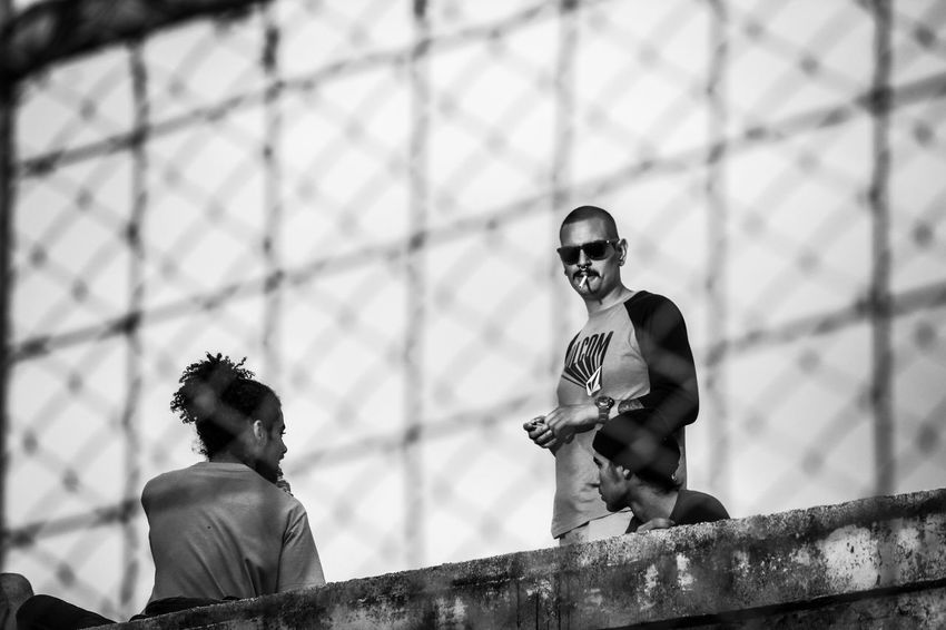 vatos Street Photography Best EyeEm Shot Cigarette  Smoking Playing With Filters Heredia, Costa Rica Barva Walking Around Walking Around Taking Pictures Black And White Street Streetphotography Santa Lucía Notes From The Underground Monochrome Teamwork Men Togetherness Arts Culture And Entertainment Sky Chainlink Fence Barbed Wire Razor Wire Chainlink Barricade Friend